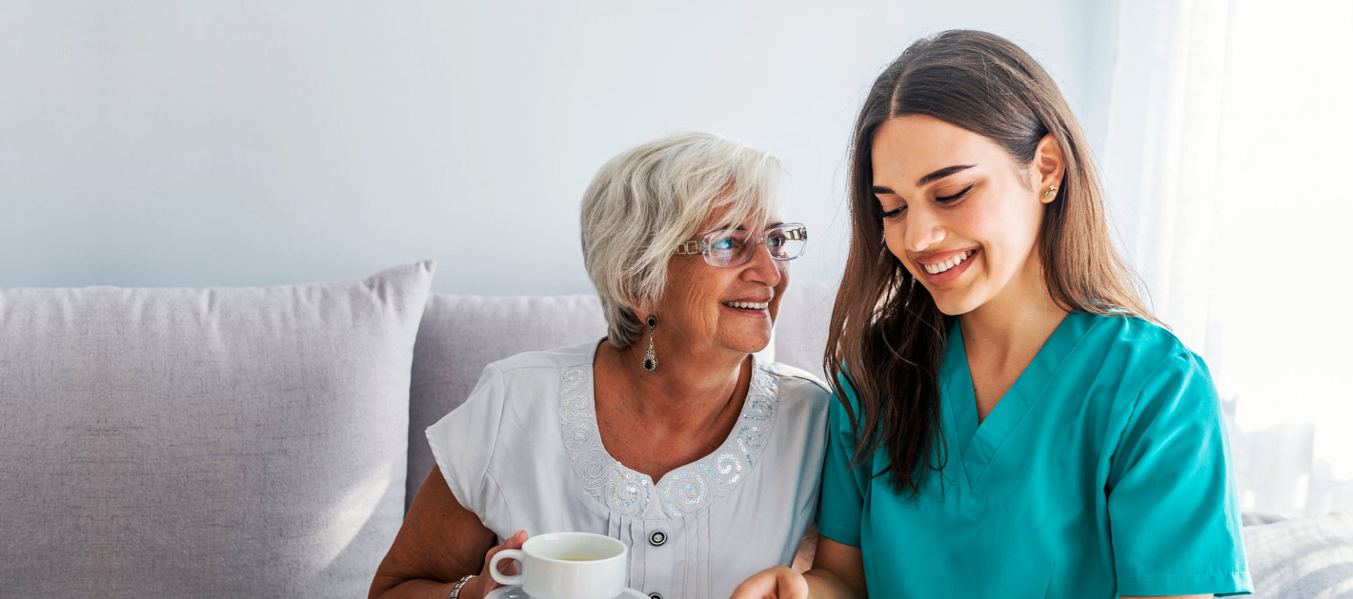 an elderly woman looking at the caregiver woman