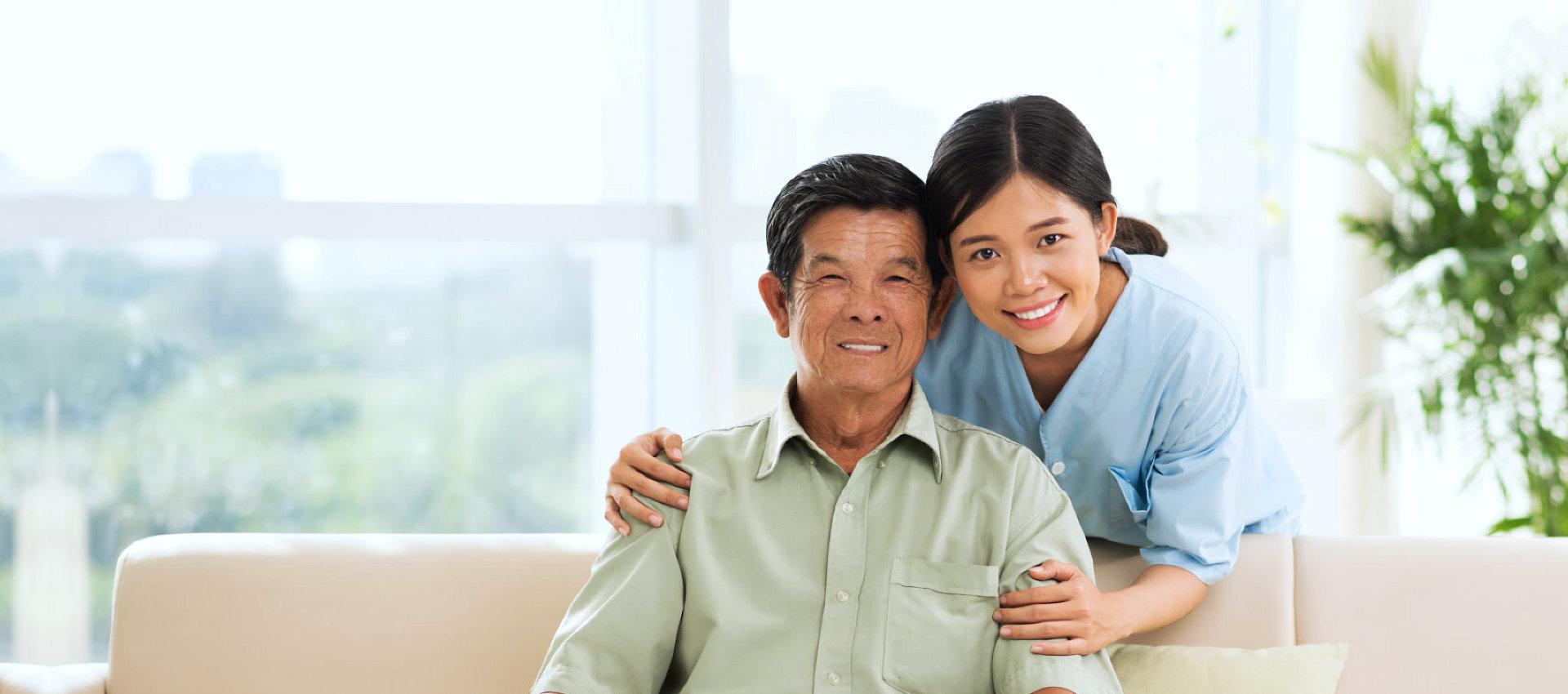 an elderly man and a caregiver woman