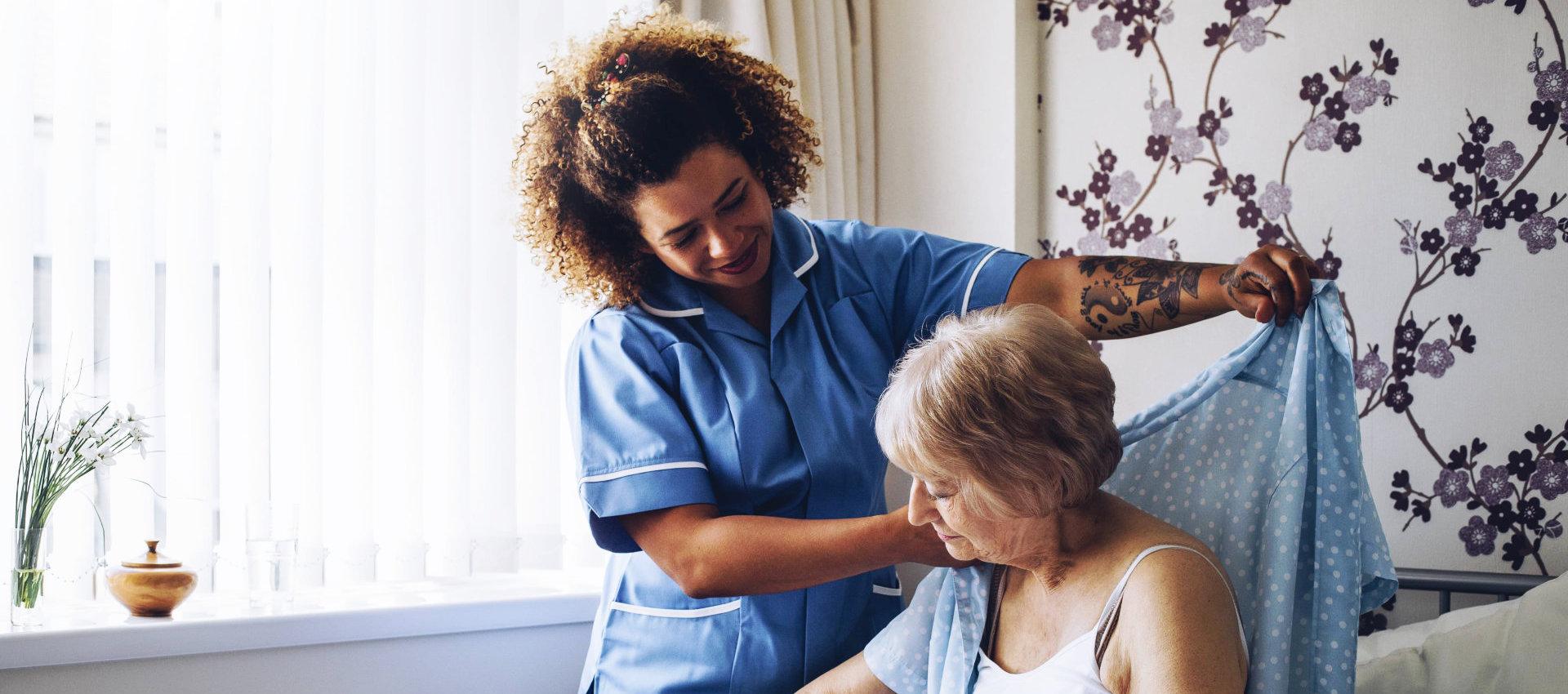 a caregiver woman helping an elderly woman